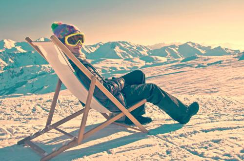 Skier lounging in chair on snow