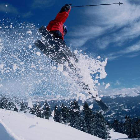 Skier going off a jump.