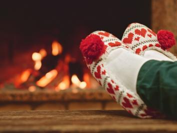 Feet infront of fireplace