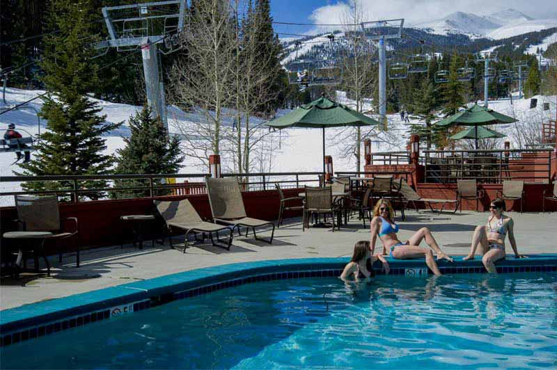 People sitting by the pool at Beaver Run Resort in Breckenridge Colorado