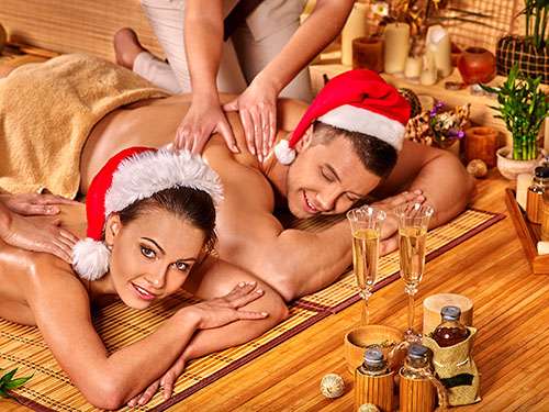 A couple receiving a Christmas massage.